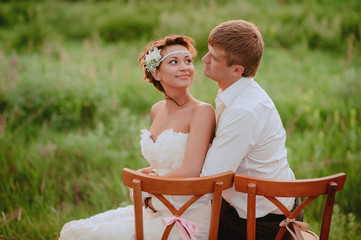 Bride looks lovingly at the Groom