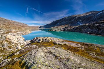 sunny autumn view Norway Gamle Strynefjellsvegen Langvatnet lake