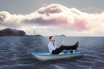 Businessman in boat with tablet pc