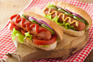 hotdog with ketchup mustard and lettuce
