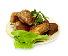 grilled meat with salad on a plate on white background