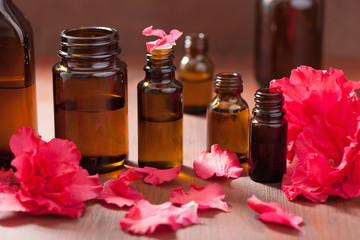 essential oil azalea flowers on dark rustic background