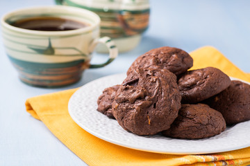 Homemade chocolate cookies on white plate