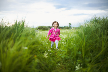 beautiful carefree girl playing outdoors in field