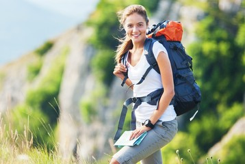 Hiking. Healthy lifestyle woman smiling outside