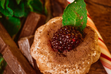 peppermint candy chocolate muffin with blackberries and mint