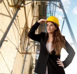 female engineer with scaffold in the background
