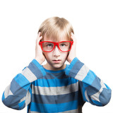 Portrait of a thoughtful preteen boy, white background