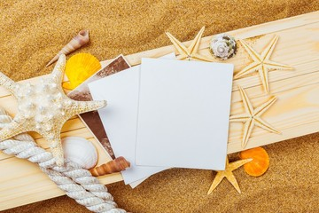 Beach. Few marine items on a wooden boards against sandy