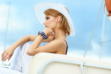 Beautiful woman on a sailing boat