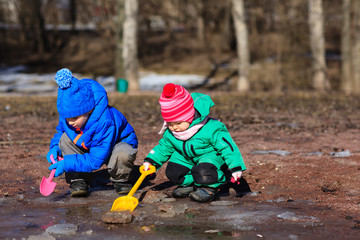 kids playing with water in spring