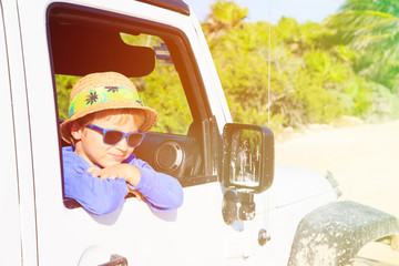 happy little boy in off road car