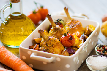 Crispy Baked Chicken Leg with vegetables and herbs