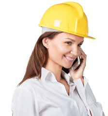 Industry. Woman engineer on the phone
