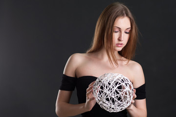 the blonde holds a white sphere