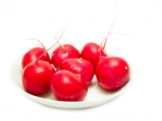 red radish on a plate on a white background