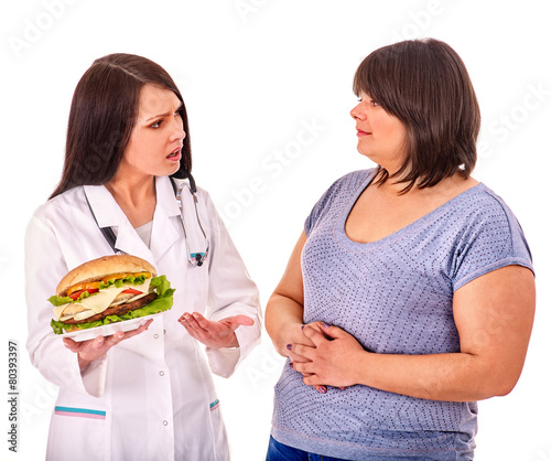 Woman with hamburger and doctor. - 80393397