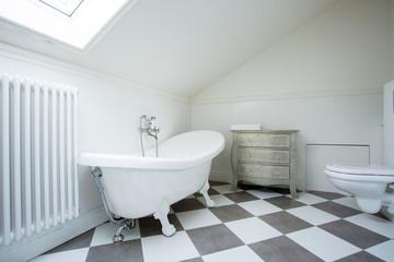 Bright bathroom in the attic
