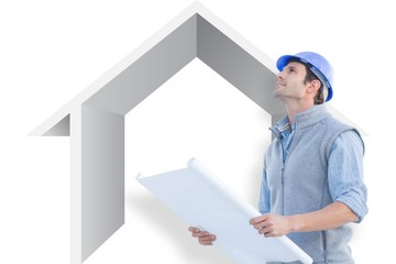 Composite image of architect with blueprint