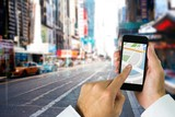 Composite image of man using map app on phone - Fine Art prints