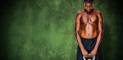 Composite image of shirtless fit young man lifting kettle bell
