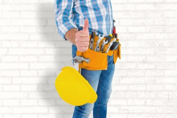 Manual worker gesturing thumbs up