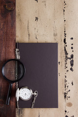 Book with pocket watch