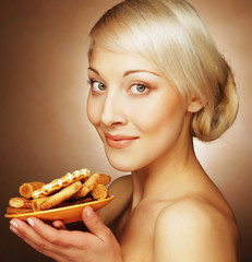 young attractive woman with cookies