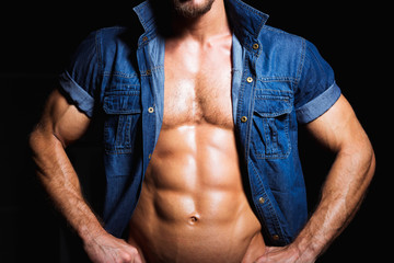 Muscular and sexy young man in jeans shirt