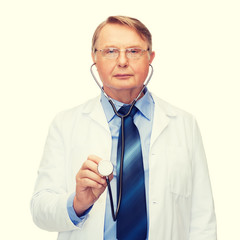 smiling doctor or professor with stethoscope