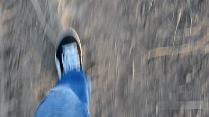 Short footage panning legs during walking.