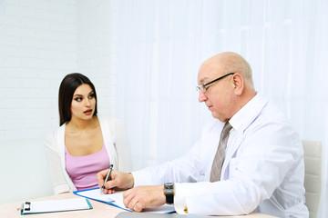 Professional doctor receiving patient in his office