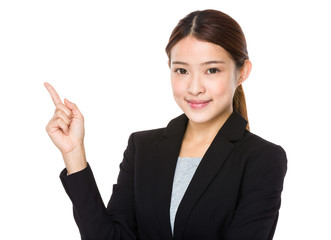 Businesswoman pointing up