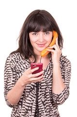 beautiful young woman using retro orange and mobile phone