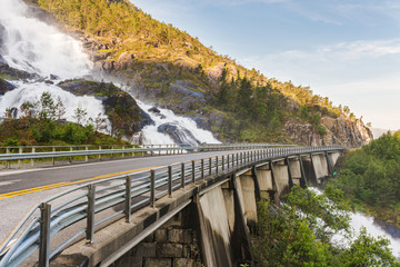 Road in Norway passing over the waterfall Langfoss