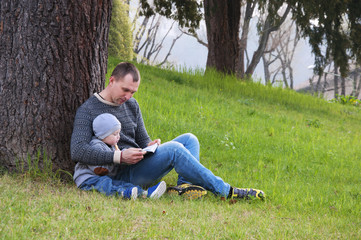 dad and son reading a book