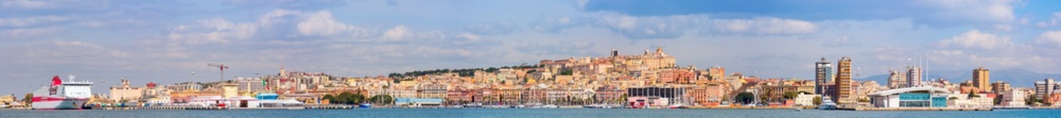 Very long panoramic skyline of Cagliari seen from the sea