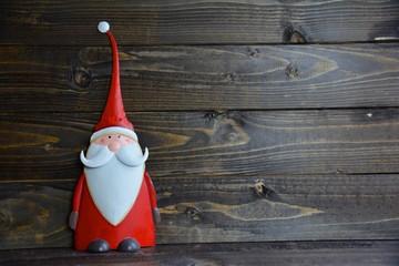 Weihnachtskarte - Holzhintergrund mit Weihnachtsmann