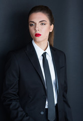 Woman dressed in man suit