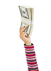 Child hand holding stack of dollars