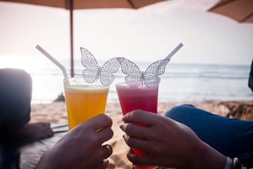 honeymoon couple lying at sunbed near the blue ocean
