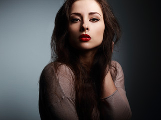 Sexy makeup woman with red lipstick looking on dark
