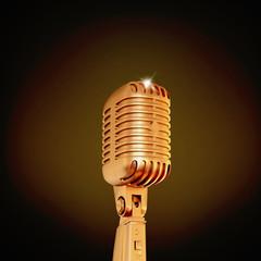 Golden retro microphone on black background.