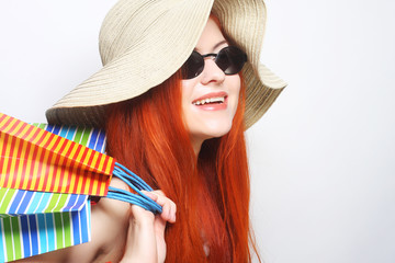 redhair shopping woman wearing sunglasses and hat