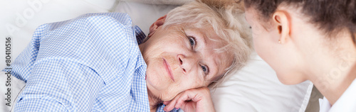 Elderly woman in bed - 80410516
