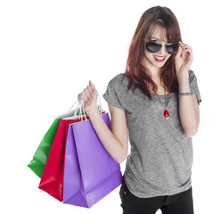 Smiling Young Woman Carrying Shopping Bags