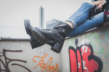 Detail of a young woman wearing biker boots