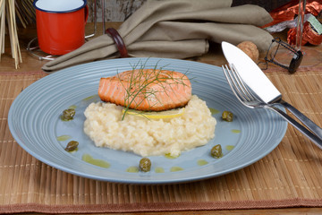 salmon fillet with lemon and dill risotto, capers seasoned