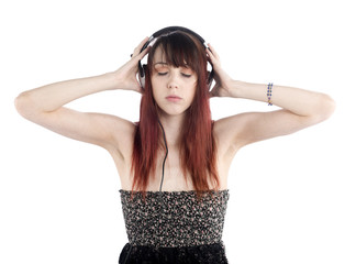 Young Woman Listening to Music Using Headphone