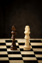 Chess board with black and white king side by side